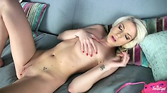 Blonde shows off some skin and starts to furiously rub her pink slit