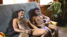 Ebony gay lovers engage in hard anal sex and cum together on the couch
