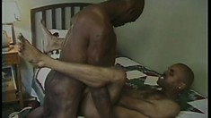 Black cocksucker lies on the bed and takes a stiff dick up his tight ass